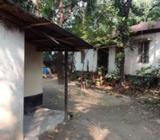 Urgent plot sale with building